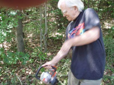Robin Starting the Chain Saw