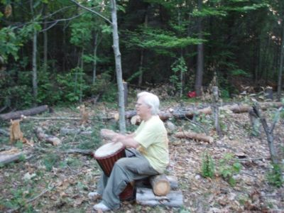 Robin Armstrong drumming in the circle 2