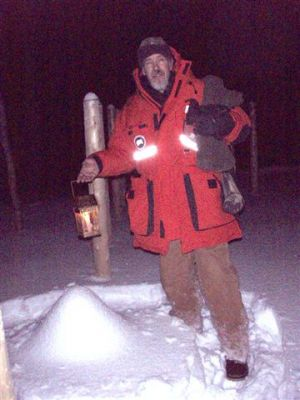 Forest Woodhenge - Winter Solstice night - Bill Frey Putting a lantern on Star Stump!
