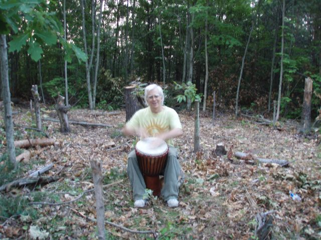 Robin Armstrong drumming in the circle