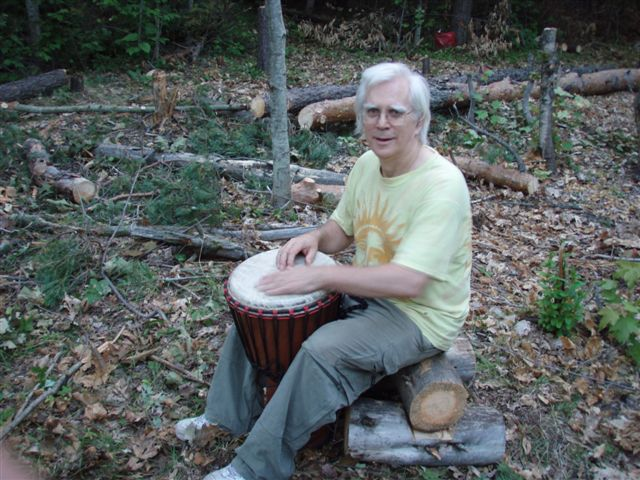 Robin Armstrong drumming in the circle 3