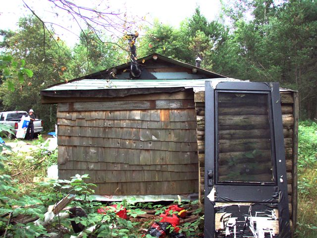 Cabin: Back side with Woodshed!