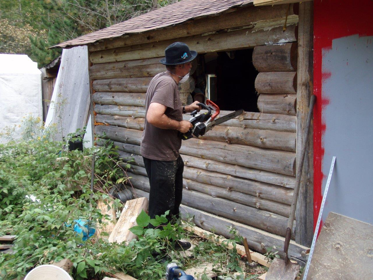 Bill Frey Cutting New Window in Log Cabin (2)
