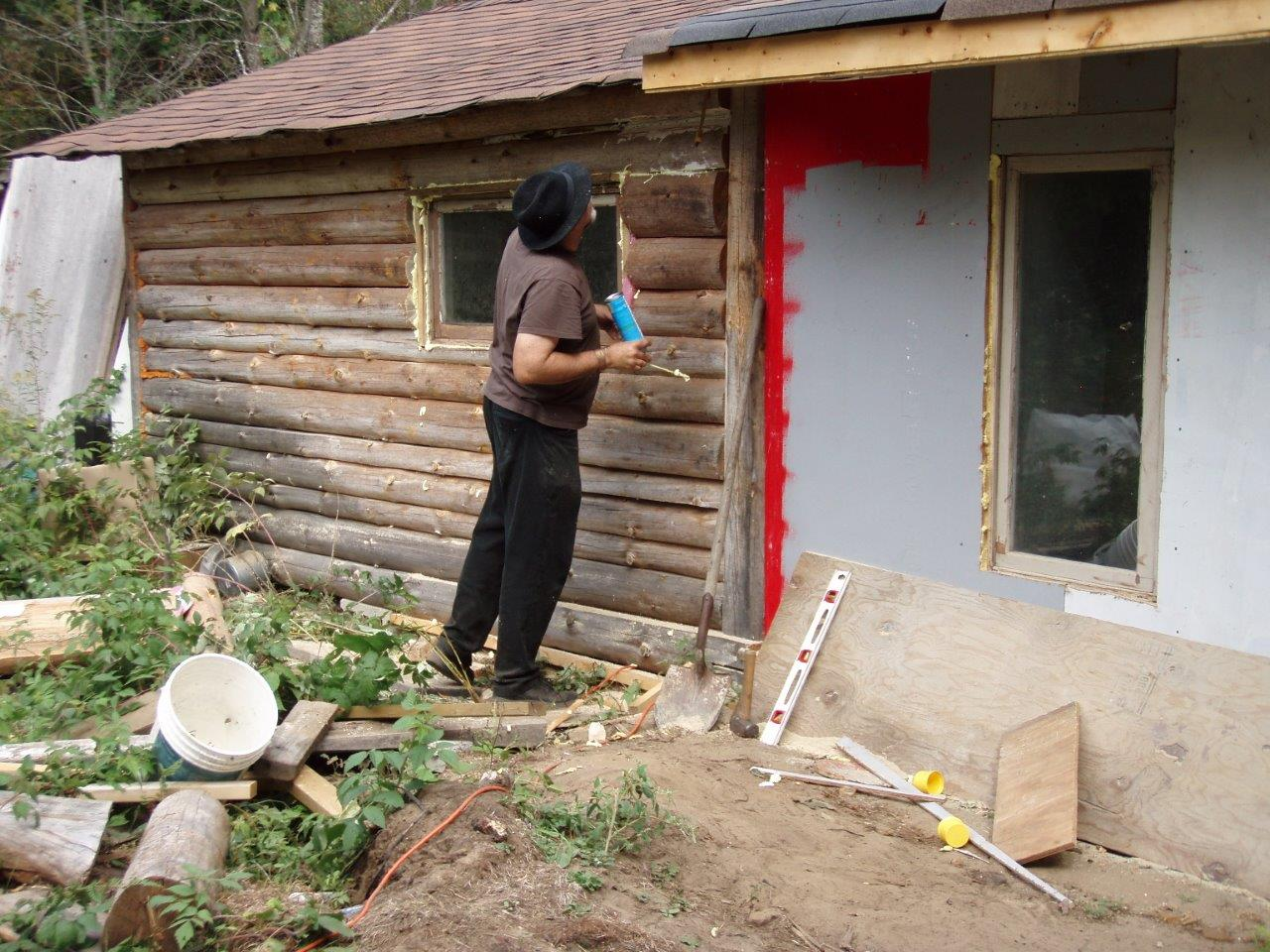 Bill Frey Cutting New Window in Log Cabin (6)
