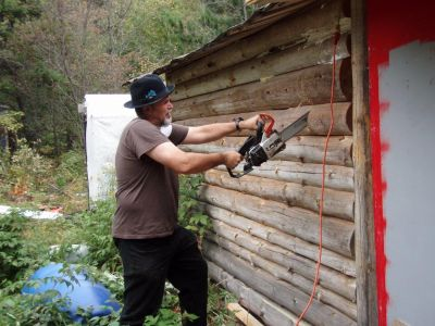 Bill Frey Cutting New Window in Log Cabin (1)