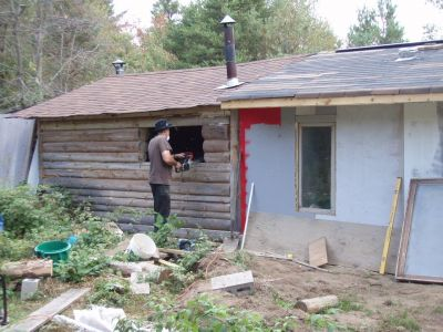 Bill Frey Cutting New Window in Log Cabin (4)